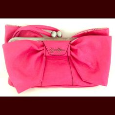 ‼️HOLIDAY SALE‼️Jessica Simpson Pink Bow Clutch Brand new with tags! Gorgeous clutch handbag with wrist strap and top kiss closure. Vegan leather. Please ask all your questions before you purchase! I am happy to help! Sorry, no trades. Please, no lowball offers. Happy Poshing! Jessica Simpson Bags Clutches & Wristlets