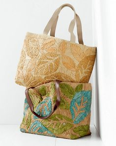 Woven of beach-ready raffia in a tropical leaf pattern, this smart tote is beautifully hand-embroidered and generously sized for carrying swim essentials or office necessities.