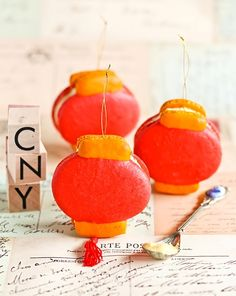 Chinese lantern macarons with jackfruit buttercream  from Raspberri Cupcakes