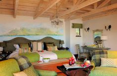 Feel the heartbeat of South Africa's history in this luxury Robben Island Suite in Cape Town. Cape Town Hotels, Busy City, Best Hotels, Luxury Hotels, Mural Painting, South Africa, Bed, Room, Furniture