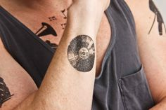 VINTAGE ALBUMS (set of 2 temporary tattoos) - There's nothing cooler than putting vinyl on your skin and turning your body into a record player. You never know what will come out of the speaker on your face with a little change of pace. $5
