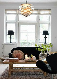 a danish family home by the style files - white living room, black sofa, artichoke light Home And Living, Home And Family, Simple Living, Family Room, Living Room Decor, Living Spaces, Living Rooms, Black Sofa, Black Armchair