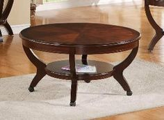 """Brownstown Round Coffee Table in Brown by Crown Mark by CrownMark. $265.80. Featuring a bottom shelf. Brown Finish and Wood Frame. Brownstown Round Coffee Table, featuring a brown wood finish and a bottom shelf, is a sleek option for your living room or dining room. Dimensions:40""""RD X 20""""H Some assembly may be required. Please see product details."""