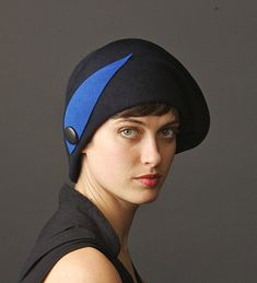 734d04a35d0282 black cloche felt hat with blue ornament, see more hats at www.yellowfield.