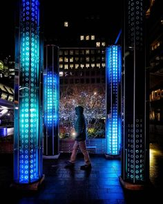 """#passerby   @yourcanarywharf #WinterLights #lightfestival #cathedralofmirrors #CanaryWharf #MadsChristensen  Check out my story for various multible throwbacks to.. """"Cathedral of Mirrors"""" by Mads Christensen is an installation consisting of twelve towering columns of light respond to visitors movements via high-tech sensors. Pulses of light are sent racing through the columns generating more light energy as people congregate. Cathedral of Mirrors envelops viewers in a three-dimensional field…"""