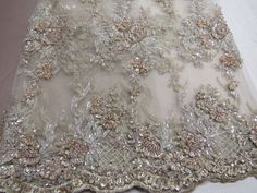 Super Bridal luxury wedding beaded beige mesh lace fabric. Sold by the yard