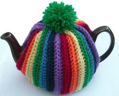 A traditional style tea cosy using double knitting / worsted weight yarn. The best kind of tea cosy: ribbed with a pompom on top.