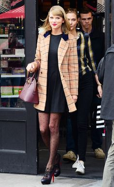 Taylor Swift in her usual stunning, ladylike look: Colorful coat + LBD + swiss dot tights + top-handle purse + lace-up Louboutin booties