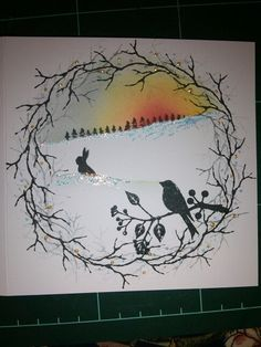 Bird and bunny christmas woodland scene. Cardio stamps and versa colour inks. Hand stamped christmas card.
