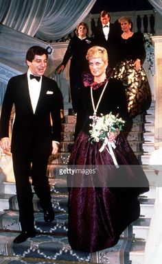 Diana, Princess of Wales, wearing a long purple Catherine Walker evening gown, attends a charity evening on behalf of Birthright at Garrard the Jewellers on October 27, 1987 in London, England.