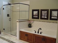 Fieldstone cabinetry, custom shower w/acrylic sides and base. The bathtub is finished with cabinet doors to tie it to the vanity cabinety