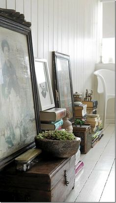 trunks, stacks of books + framed art leaning against the walls #homedecor