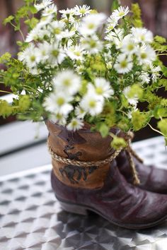 I like the idea but i want white boots and purple flowers for my centerpieces.