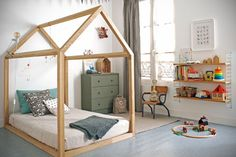 A house-framed floor bed in a Montessori-Inspired Toddler Room - Photo via RockRoseWine. Learn how to create a safe and educational Montessori bedroom or nursery for your little one using these simple tips. Big Girl Rooms, Boy Room, Kids Rooms, Child's Room, Toddler Rooms, Room Kids, Floor Bed For Toddler, Toddler Bedroom Boys, Toddler Bed On Floor
