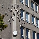 Artist Installs Flocks of Surveillance Cameras and Satellite Dishes in Outdoor Settings