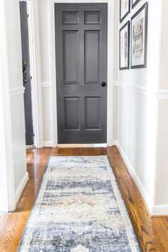 DIY and decorating ideas to add interest to a boring window-less hallway + thrifting project tutorials and free printables to pull it off inexpensively. Entryway Paint, Hallway Paint, Dark Hallway, Hallway Walls, Long Hallway, Upstairs Hallway, Entryway Rug, Entry Hallway, Hallway Ideas