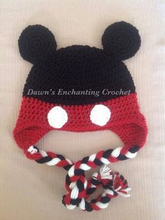 Crocheted mouse hat with ear flaps and tassels