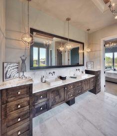 Rustic Wood Vanity With Dual Sinks - This rustic wood vanity is complemented by interesting lighting elements