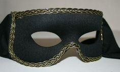 Black masquerade mask with black and gold braid edging, suitable to be worn with glasses