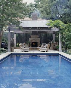 Use these outdoor fireplace ideas to give your deck, patio, or backyard living room a dramatic focal point. Browse pictures of fireplace designs for decorating ideas, inspiration, and tips on how to build an outdoor fireplace. Pool Cabana, My Pool, Outdoor Rooms, Outdoor Living, Outdoor Furniture, Piscina Rectangular, Living Pool, Rectangle Pool, Square Pool