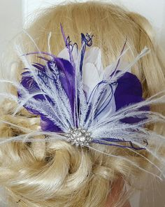 Check out this item in my Etsy shop https://www.etsy.com/listing/266583311/purple-white-hair-fascinator-feather