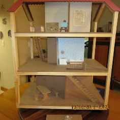 Collapsible Dolls House with furniture - back view. Made in George, South Africa. Ben.engelbrecht@serenipity.org.za