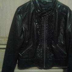 Black leather jacket Black faux leather jacket with rufle detail on front. Has two zip pockets on front excellent condition no flaws Rampage Jackets & Coats