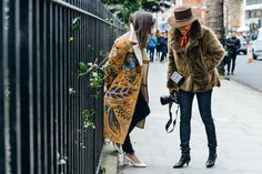 Women's fashion | street style, chatting in stunning flower printed camel coloured coat • statement coats A/W 15/16
