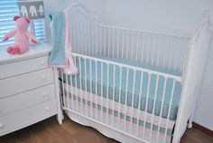 Aqua Diamonds, White quilting and pink stripe-effect with trims on the crib skirt