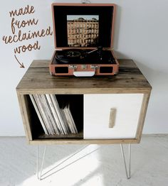 "Modern Arks made you a place to store your records! This record cabinet is around 25"" Long x 15"" Deep x 29"" Tall and features an authentic reclaimed barn-wood exterior with one white-washed sliding door. Store hundreds of your favorite LPs in this mid-century modern styled reclaimed wood storage piece. The Eames style hairpin legs complete the feeling of nostalgia while offering a truly one-of-a-kind finish."