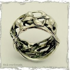 Sterling silver ring with pearls.