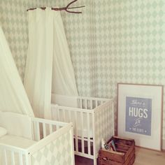 I adore the old fashioned drapery around the front of each crib :)