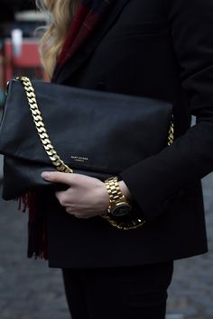 Black leather and gold chain purse