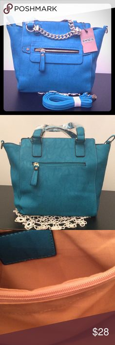 """TEAL CHACAL TAYLOR BAG 10""""X15""""X5"""" NEW TEAL CHACAL TAYLOR BAG WITH SILVER HARDWARE. ZIP CLOSURE AND ON FRONT SILVER CHAIN DETAIL AND A ZIP POCKET. ON BACK A ZIP POCKET BUT NO CHAIN DETAIL. INSIDE IS TAN WITH MIDDLE ZIP POCKET AND A ZIP POCKET ON ONE SIDE. TWO OPEN POCKETS ON OTHER SIDE.  BRAND NEW HAS A SHOULDER STRAP. chacal taylor Bags"""
