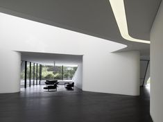 Designed by Germany-based J. Mayer H. Architects, 'Dupli Casa' is a modern villa near Ludwigsburg that features sleek sculptural and futuristic elements. The geometry of. Villa, Architecture Details, Interior Architecture, Different Types Of Houses, Piscina Interior, Futuristic Interior, Interior Minimalista, Modern Interior Design, Minimalist Design