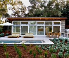 Remodeled House With Large Manmade Pond Near It | DigsDigs