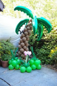 """7'-0"""" tall palm tree using metal conduit, 10 palm leaves, and brown balloons from Qualatex. http://www.magickalentertainment.com"""