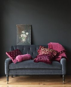 I like the moody grey walls and pop of rich color on the sofa....you have a similar mood with the rich green and deep orange, reds...warm tones... autumnal bliss year round!