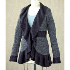 """Plus Size Sweater With Ruffles Size 2X Plus-Size Ruffle Trim Sweater adds flair to your wardrobe as the temperatures begin to dip. Elegant ruffle details along the collar and around the sweater's lower hem form a flattering shape for any figure. Marbled cardigan has a solid band at the waist and solid cuffs. Button-and-tie closure allows you to wear it closed or as an open-front sweater. Lengths is 32"""". Acrylic. Machine wash. Imported.  Fun and flirty ruffles create a feminine style…"""