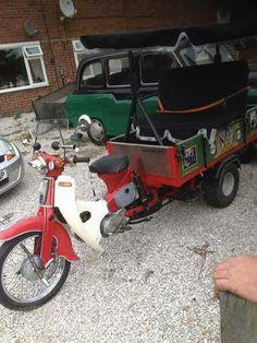 Eine Honda Cub als Lasten-Trike, vermutlich Großbritannien