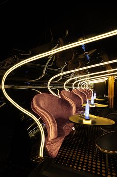 Bond Nightclub, Melbourne - It's 'Bond', a place built upon bold spaces, bold design and bold harmonies which evoke a sense of confidence, as if you've ordered a martini shaken not stirred and are playing it effortlessly cool. The sleek lines and curvature in the design mimic the music which pulsates from wall to wall and overtime as the music has evolved so has the place, into a sophisticated sub-ground lair with just the right amount of retro edge.