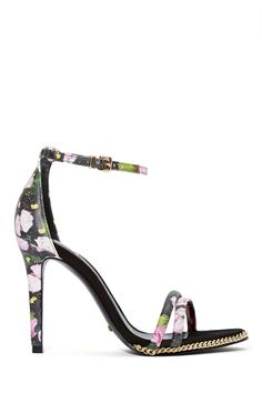 Grow a pair, or just buy them. These floral beauties by Schutz can be worn with a LBD and an oversized leather clutch.