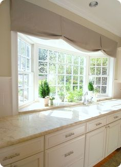 Beautiful window  Nice to have kitchen sink where you can see out   Neat setup for the window being a bay window