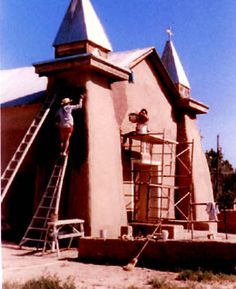 """The Old Church in Corales, NM.  Photo: The Preservation & Mantenance Committee sponsors """"Mudders' Day"""".  People come together to mix & reapply adobe mud to the walls in order to keep up restoration."""