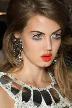 red lip + white eyeliner + false lashes at moschino spring 2013