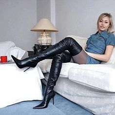 Blonde on couch in black leather thigh boots #hothighheelsmistress