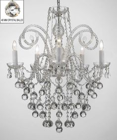 This beautiful Chandelier is trimmed with SPECTRA(tm) CRYSTAL Ð Reliable crystal quality by Swarovski¨!  <br>Swarovski¨ is the world's leading manufacturer of high quality crystal. SPECTRA(tm) CRYSTAL...