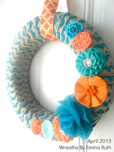 Burlap strip wrapped wreath. I could buy the fabric flowers pre-made from Hobby Lobby.
