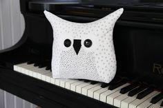 snougle-piano-1