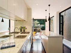 full wall of glass doors make the alley a usable courtyard space and bring in natural light